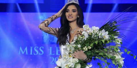 Lebanese Sandy Tabet, 22, fixes her crown after winning the Miss Lebanon 2016 contest at Casino Du Liban in Jounieh, north of Beirut, Lebanon, late Saturday, Oct. 22, 2016. (AP Photo/Bilal Hussein)