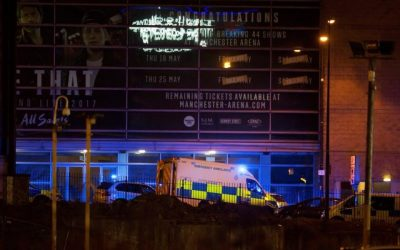 1024203-a-police-van-and-an-ambulance-are-seen-outside-the-manchester-arena-where-us-singer-ariana-grande-ha