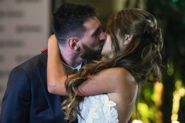 "Argentine football star Lionel Messi and bride Antonella Roccuzzo pose for photographers just after their wedding at the City Centre Complex in Rosario, Santa Fe province, Argentina on June 30, 2017. Footballers and celebrities including pop singer Shakira gathered Friday for the ""wedding of the century"" in Lionel Messi's Argentine hometown as the Barcelona superstar prepared to marry his childhood sweetheart Antonella Roccuzzo. / AFP PHOTO / EITAN ABRAMOVICH"